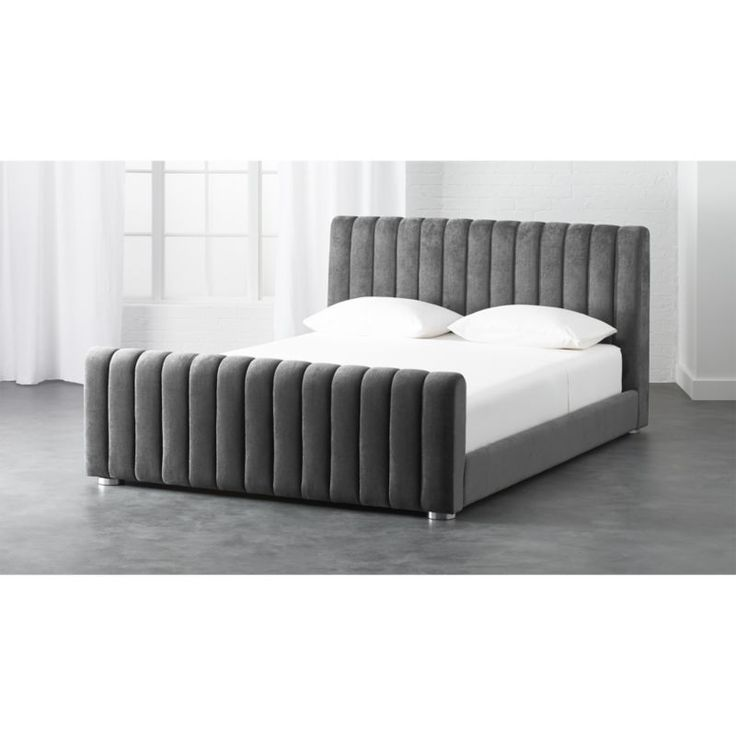 Shop reign velvet bed.   Cushy channels of plush grey velvet give Reign its regal vibe.  Designed by Amanda Ip of Slate Design, fully upholstered, low-profile bed boasts a high headboard/low footboard combo creating an elegant, almost retro silhouette.