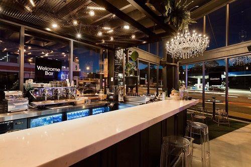 quartz countertop in Smartstone Carrara at Novak Properties office coffee bar by Codef
