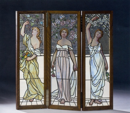 probably american early century a stained glass folding screen each depicting a maiden in long flowing gown among flowers and frui