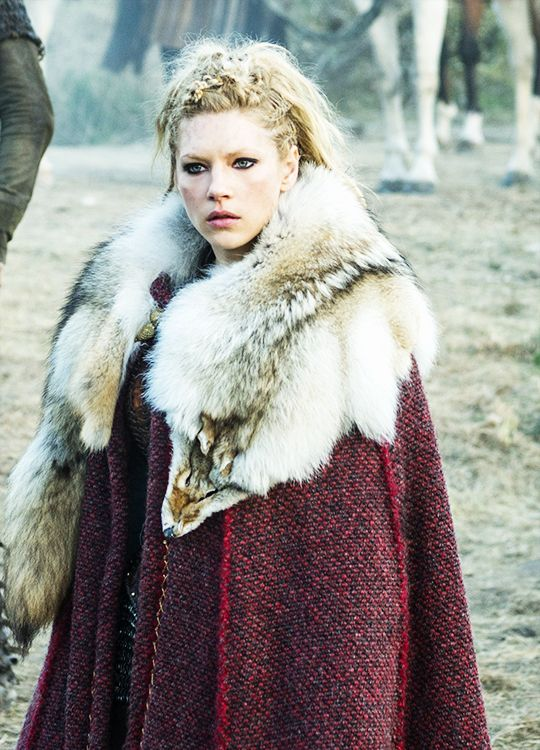 Noblewoman wearing a thick dyed wool cloak and wolfskin.                                                                                                                                                                                 More