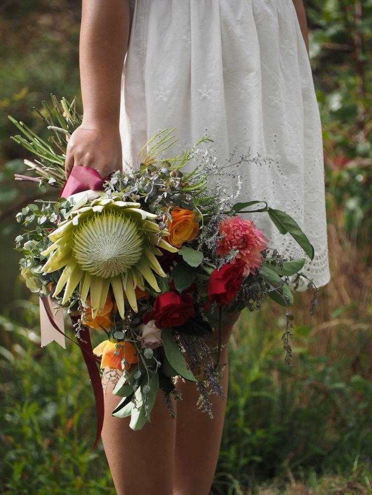 Colourful wedding bouquet, pink, orange, red, white | white king protea | pink dahlia | orange roses | red roses | eucalyptus | Sydney florist | hunter gatherer florist