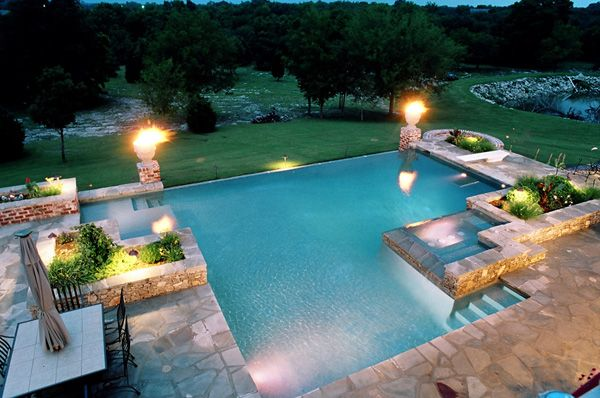 raised edges, zero edge. irregular shape and the planter boxes all help define connected table space and connection with landscape. Portfolio page for Atlantis Pools Tulsa Oklahoma inground in ground swimming pool pools builder contractor