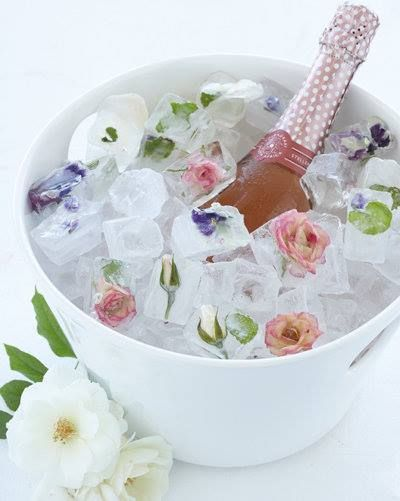 Ice cubes with edible flowers, fruits and herbs look pretty