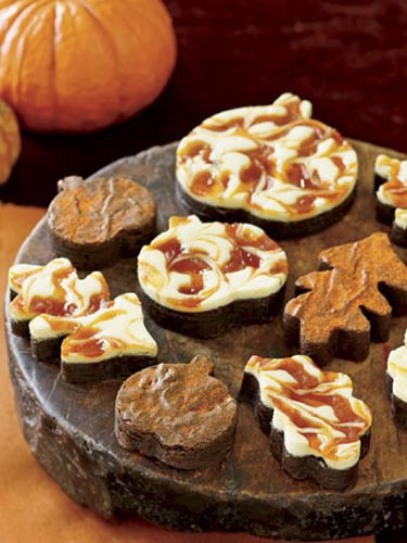 Topped with cream cheese frosting and swirls of pumpkin butter, these are no ordinary brownies. Cut into autumn shapes, such as pumpkins and leaves, and then arranged on an antique cutting board, these brownies make a scrumptious display.