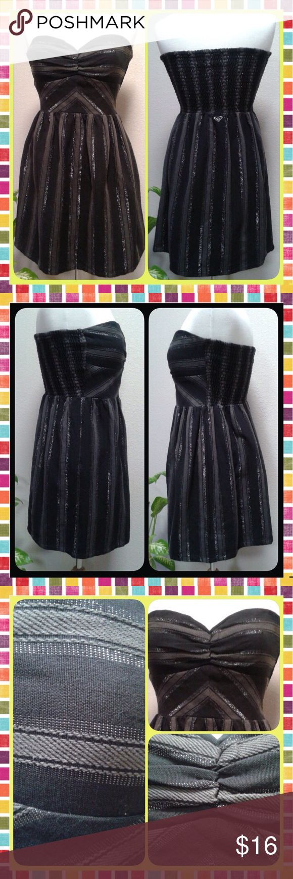 """Black & Silver Sweetheart Dress Great, little dress by Roxy.  Medium weight/denim-like fabric in dark charcoal/gray stripes, woven with silver thread.  Perfect for Girls Night Out or Date Night.  Sweetheart strapless neckline, stretch smocked back provides support, flattering waistline.  Junior Large, Measures: Chest (armpit to armpit) 16""""   Length (top of chest to hem) 25""""   Waist (seam to seam) 16"""". Like New, worn a couple of times, no defects. Roxy Dresses"""