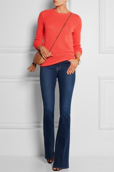 Chinti and Parker (sweater). Frame Denim (jeans). Tabitha Simmons (sandals). Alexander Wang (bag).