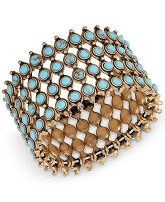 Four interconnected rows of turquoise colored beads make Lucky Brand's cuff bracelet a stunning style accent. Crafted in gold-tone mixed metal. Slip-on design. Approximate diameter: 2-1/2 inches. | Ph