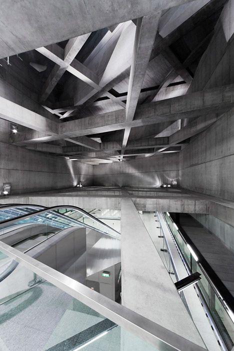 Cavernous Budapest metro stations feature concrete lattice overhead.