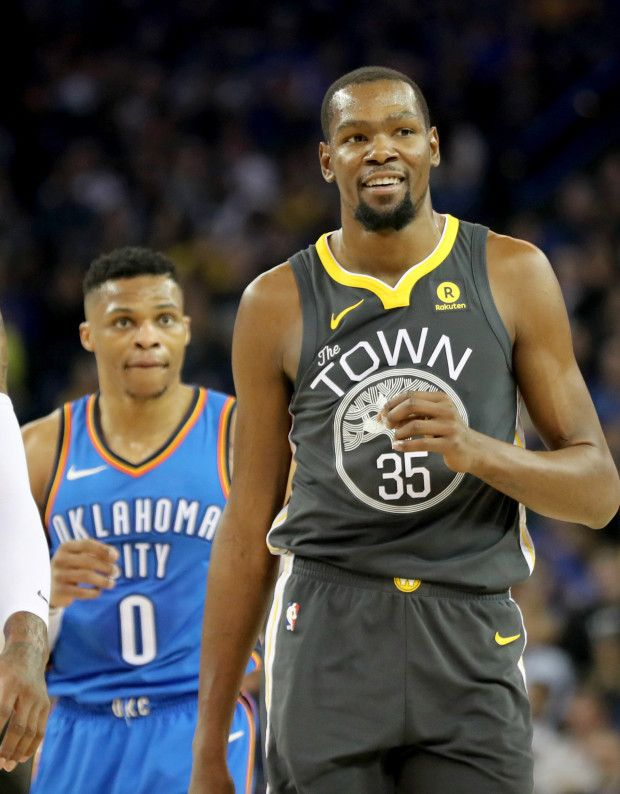 ac18114406f Golden State Warriors  Kevin Durant (35) reacts after walking past Oklahoma  City Thunder s Russell Westbrook (0) in the first half of an NBA game at  Oracle ...