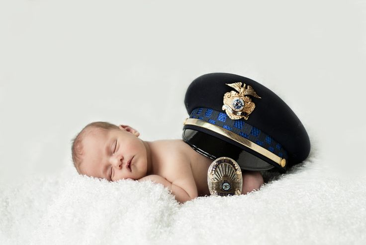 Natural light newborn photography | Cop policeman hat and badge | adorable skin tones | © Lucy Dennis Photography