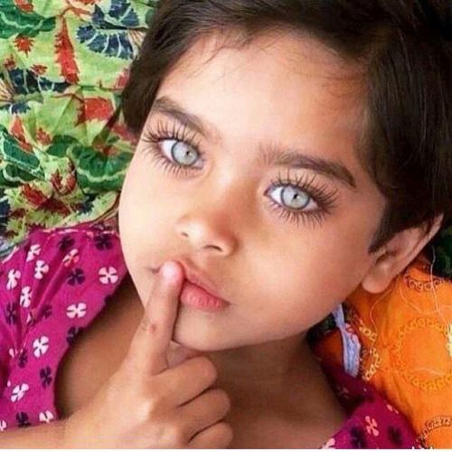 What beautiful eyes. Look at her lashes. They're a mile long! This child will…