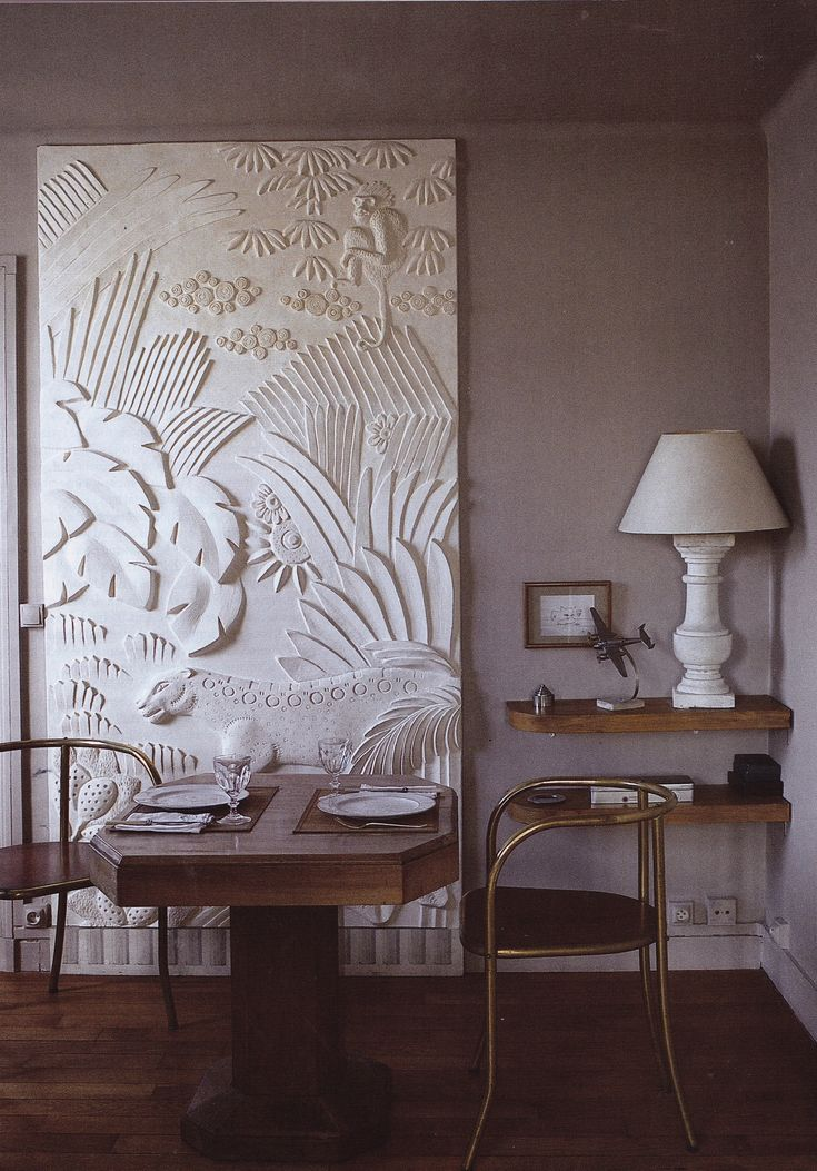Sculptor and restorer Myriam Chataignere's Paris Right Bank studio-cum-residence. A bas relief created by the artist of a 1930's drawing by Jean Dunand. Photo by Roland Beaufre, The World of Interiors.