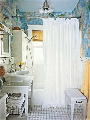 bathroom wallpapered with maps