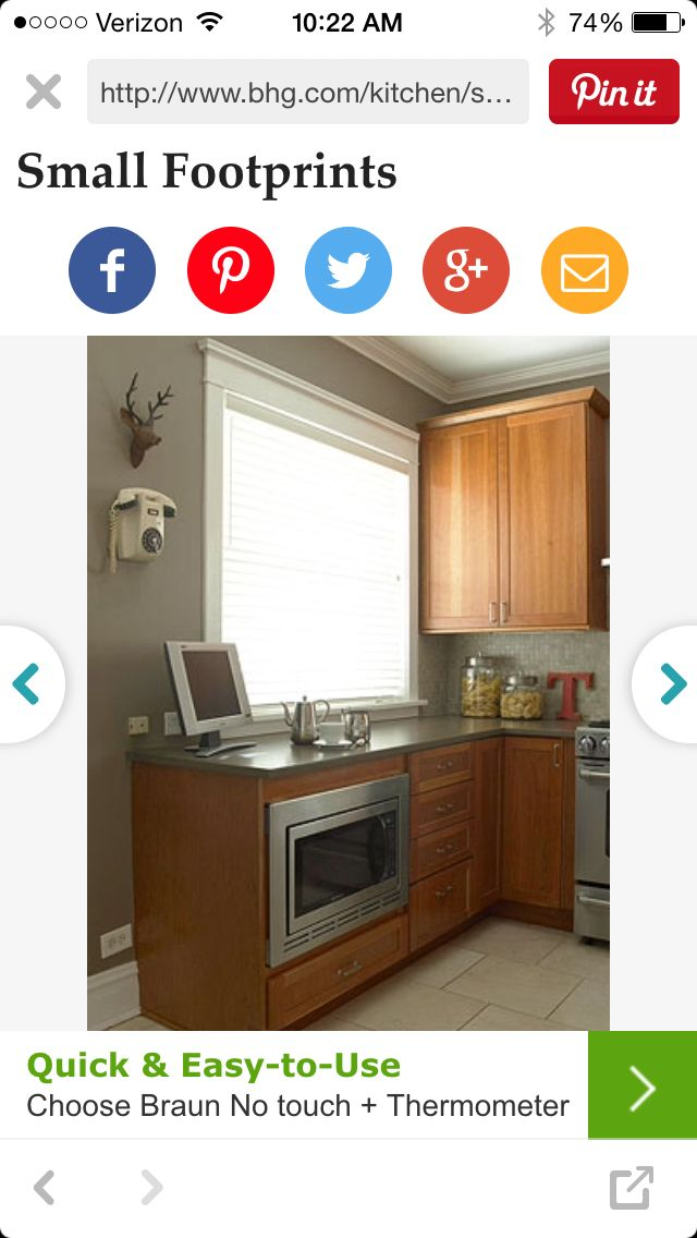 greige walls in kitchen with oak cabinets and grey