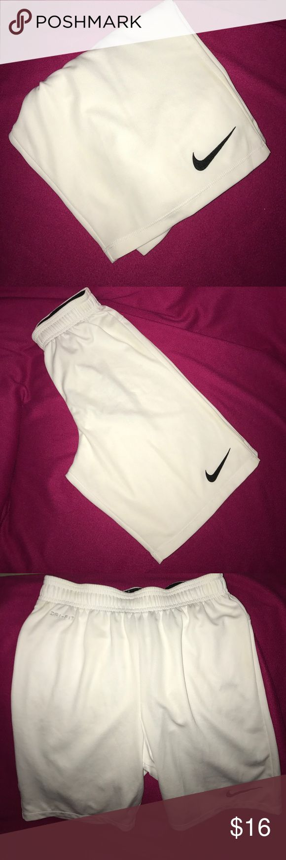 Nike Men's Shorts A pair of Men's size Small solid white Nike shorts with black drawstrings a black logo and a black waistband on the inside the waistband also has elastic the shorts are in great condition from a smoke and pet free house Nike Shorts Athletic