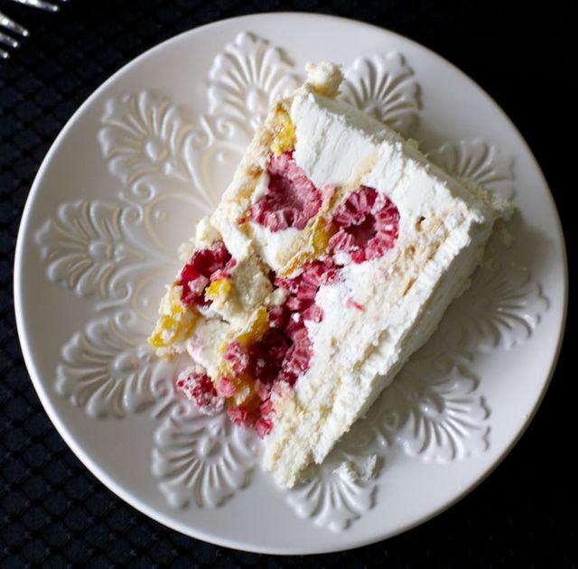 Meringue Cake with Cream, Mango Preserve, and Raspberries