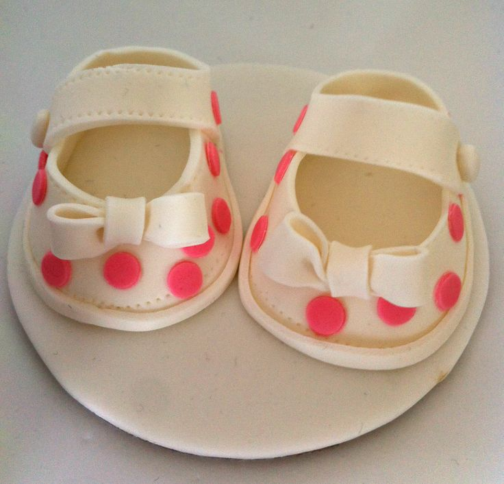 Baby shoe cake topper.