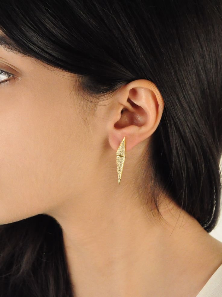 Dagger Earrings -  INR 1,999 - These minimal earring is designed like spears that are pavé set with Cubic Zirconias and Polished in 18 k Gold. They make for a perfect everyday accessory.