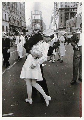 """Although we can't see the faces of the kissers in this iconic photo, Edith Shain has long claimed to be the woman. Shain, now 90, is scheduled to be the grand marshal of New York's Veterans Day parade tomorrow.    She describes this moment, caught by the photographer Alfred Eisenstaedt, as a spontaneous kiss with a total stranger in Times Square on VJ Day in August of 1945, the day WWII ended.    Miss Shain, when pressed by a BBC interviewer, described the kiss as """"wonderful."""""""