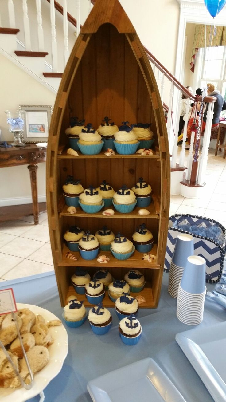 Whale themed baby show. Vanilla and chocolate cupcake with vanilla buttercream and hand piped chocolate candy anchors and whales.