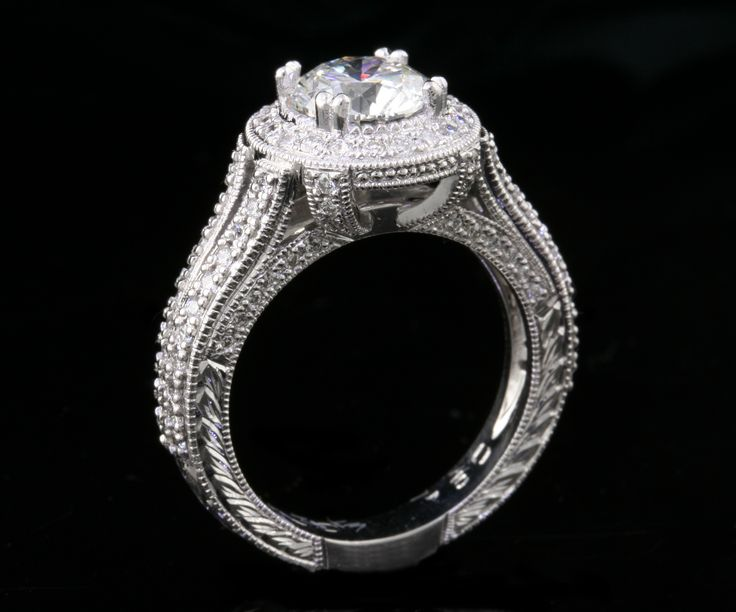 Diamond halo  engagement ring with hand engraving and millgraining in 18ct white gold