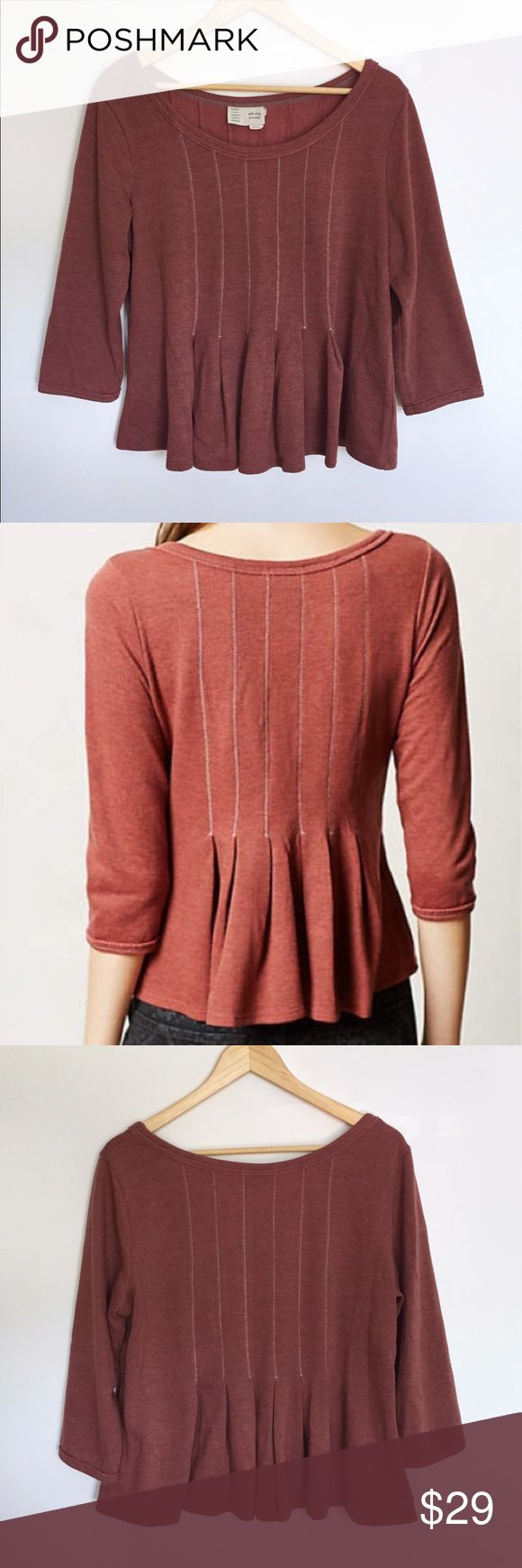 Anthropologie Saturday Sunday burnt red peplum top This top is adorable with dark jeans and a long necklace. Decorative stitching and pleating on front and back. 3/4 sleeves. Scoop neck. Comfy polyester/cotton blend feels sort of like a heavy sweatshirt. In excellent used condition except for a tiny snag in the stitching on the back (pictured). Anthropologie Tops