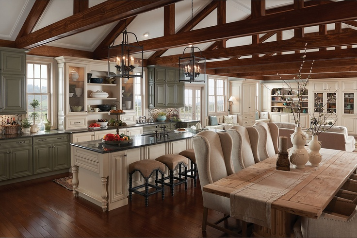 Architectural details and multiple cabinetry finishes add layers of refined rustic texture, while a long island provides prep room for cooking.
