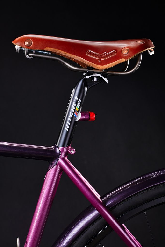 Custom made integrated seat post rear light.  Brooks England Swift Titanium and Ritchey WCS seat post.   #pilisiecki #crossbicycle #columbus #schmidt #dtswiss #selleitalia #pi #custom #bikerack #bicyceframe #bespoke #newbike #pink #eggplant #bikeporn #gravel #steelisreal #steel #trp #chrisking #ritchey #brooks #retroshift #paragonmachineworks #columbusXCR #titanium