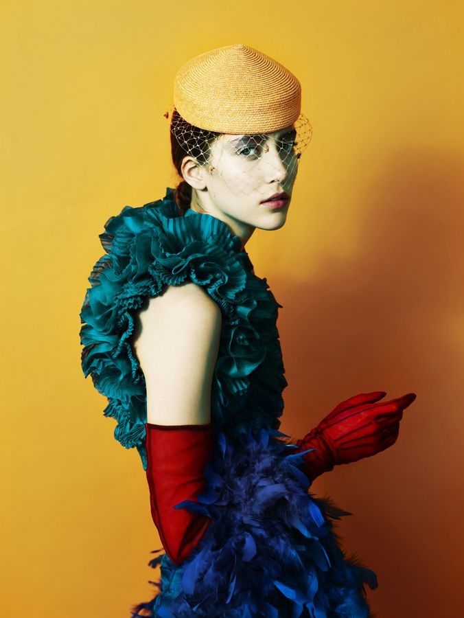 Red gloves, teal ruffled top, bright yellow hat with veil, deeply saturated colors.  What's not to love?