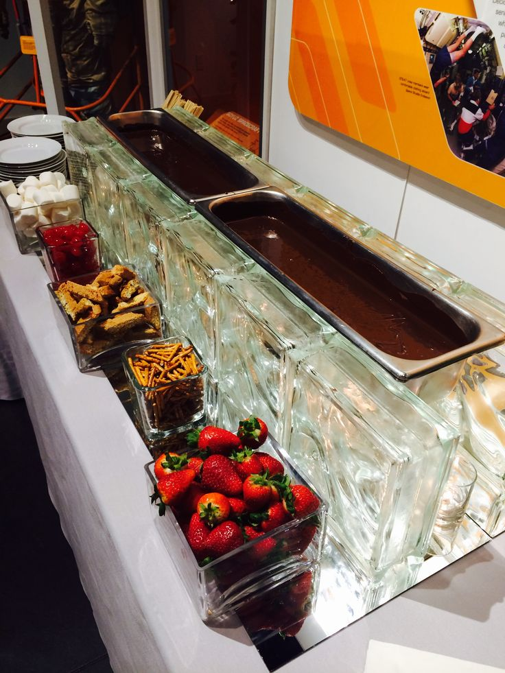 Chocolate fondue station with mirrors, candles and glass blocks.