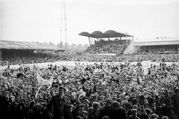 Now, this is scary! Highfield Road, Coventry in 1964, on the day that Coventry City had beaten Colchester United to gain promotion to the old Division Two. Note the one completed section (the same at the other end) of what ultimately became the Sky Blue Stand