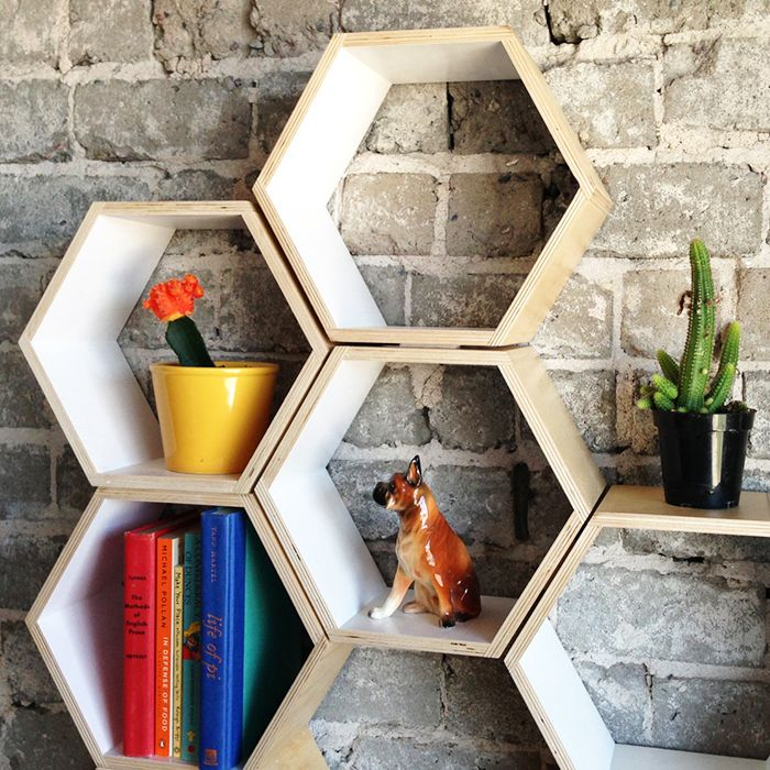 "White Hexagon Bookshelf. Dimensions: 10 3/8""h x 12""w x 6'd Materials: layered solid birch plywood 