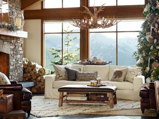 Living room` Pottery Barn. Everything. Fireplace, chandelier, rug, mantle, mountains, windows, pillows, tree... maybe a solid wood coffee table and a different colored couch- or leather.
