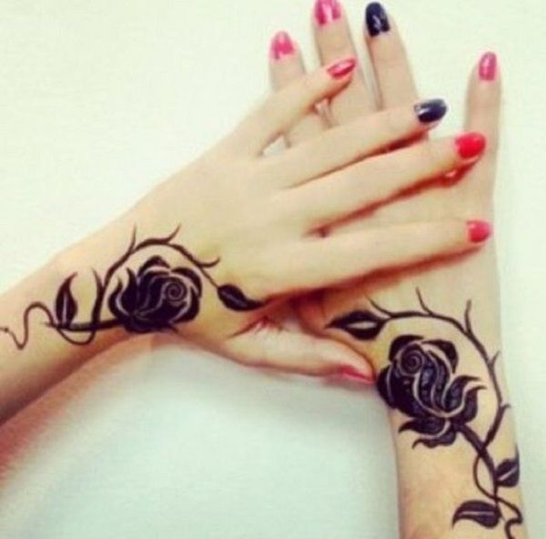 Pretty henna inspired wrist tattoo  Henna is a beautiful body art popular in southeast Asia and Arabian Peninsula. This pair of rose tattoos fuse the henna style and make it difficult to tell they are on the different wrists of sisters.