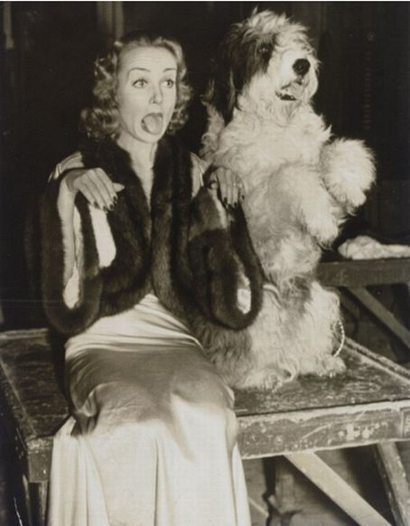 Carol Lombard and dog acting silly
