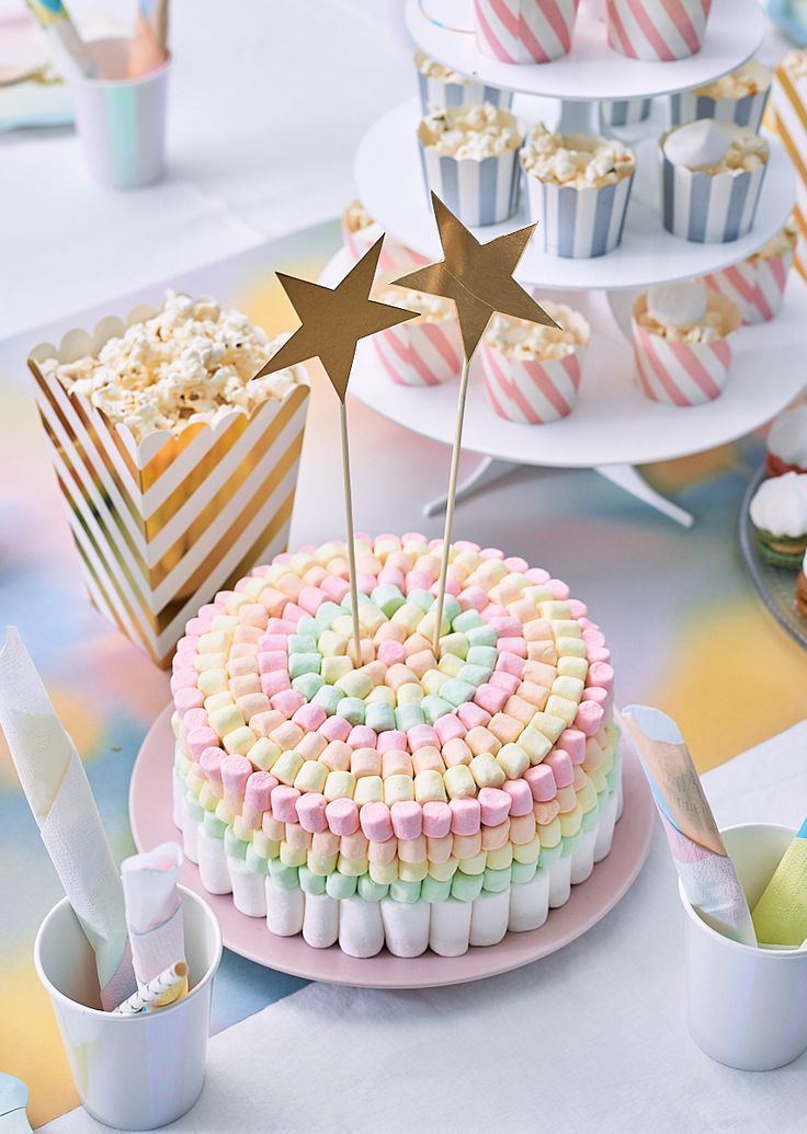 A pastel rainbow cake for a unicorn party.