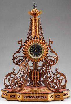 Tramp Art fretwork shelf clock having fancy shaped base with steps. Origin: France Year: 1925 - 1950