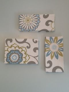 Cheap wall art: Fabric covered shoe box lids, so much cheaper than using craft store canvas!