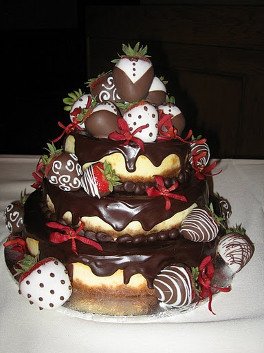 Oh this would be so awesome for the wedding cake!  Chocolate covered cheesecake with strawberries...yes please!