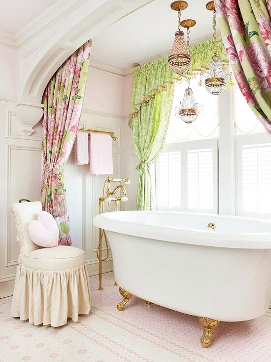 Ultimate Feminine Bathroom        An arched alcove flattered with generous windows sets up a bubble bath haven in this bathroom bursting with classic femininity. Lush floral fabrics and sweet pink tile pour on the sugary touches. The claw-foot tub with matching vintage-style faucet rests on a mosaic tile floor with crystal chandeliers glowing overhead.