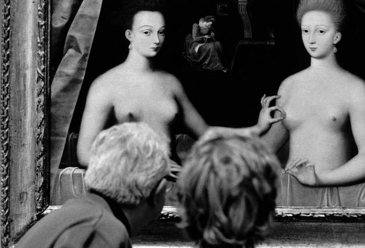 Museum patrons viewing Presumed Portrait of Gabrielle d'Estrées and Her Sister, the Duchess of Villars (c.1594). Louvre, Paris, 1975. Photograph by Elliott Erwitt. The candid gesture may be an...