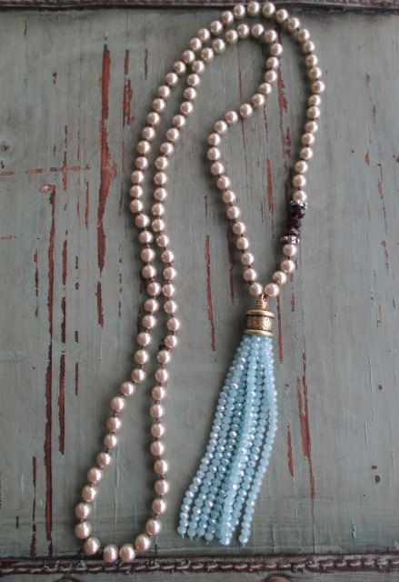 """Sky Blue tassel necklace Frozen silver pearl by slashKnots  $142 Hand-knotted glass pearls with faceted garnets and artisan sterling accents. A sparkly crystal tassel gives a very winter inspired look. Dress it up or down --- looks great worn with gray :)  Measures 32"""" with a 3 3/4"""" tassel drop.  She put 3 pieces of faceted garnets at that side point - nice balance!"""