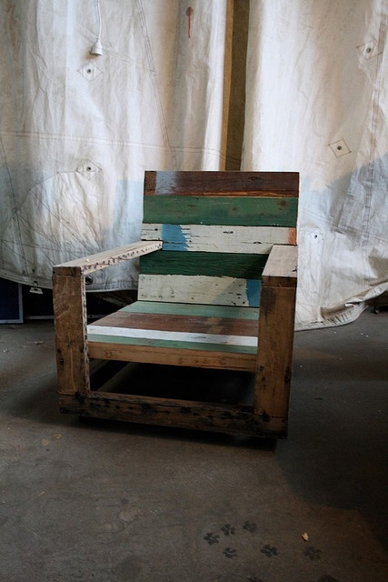 I love how the original texture of the found wood in these pallets have transformed it into a signature chair.