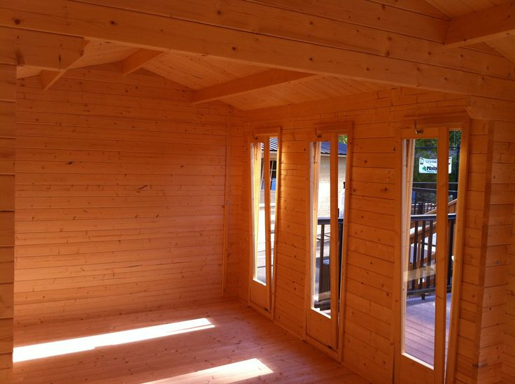 NICE - interior pic. Notice tilt windows, and finished log interior is standard with all ez log products.