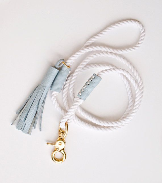 Dog leash made from 3 strand cotton rope, accented with soft powder blue leather. Its the classic rope dog lead, in a minimalist form, with a