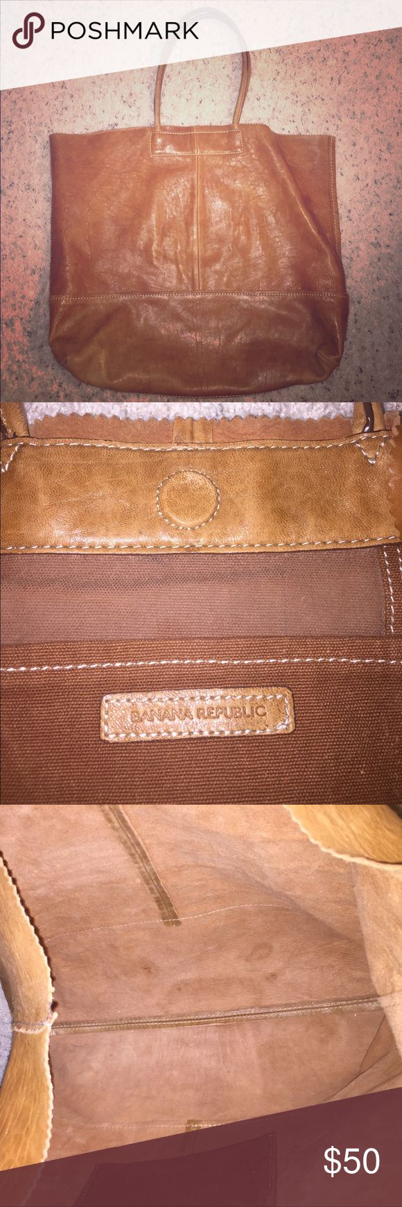 SALE!! Banana Republic tote Large camel brown leather tote with magnetic closure. Great condition. Little use, one small pen mark (pictured) Banana Republic Bags Totes