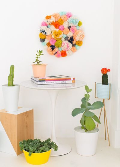 Slap some pom poms on the wall in an entirely gratuitous display of fuzzy craftiness.