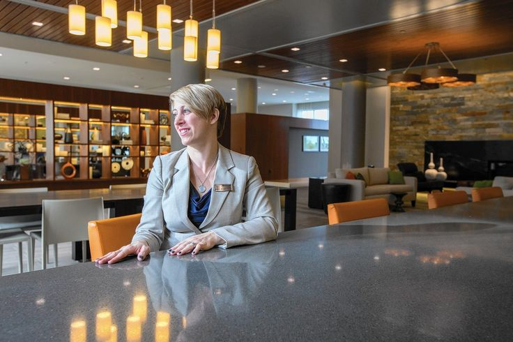 Sitting inside the modern, upscale lobby of the Metropolitan Downtown Columbia on a recent morning, Sharon Redfern runs through a mental list of upcoming and completed development projects in Columbia's downtown.