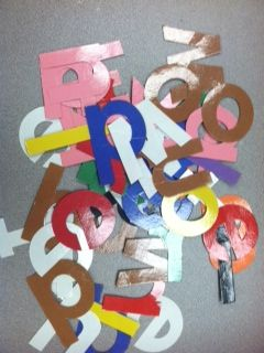 The kids dump them out on a table or on the floor and sort the letters by color. and then they spell each color word using the correct colored letters.