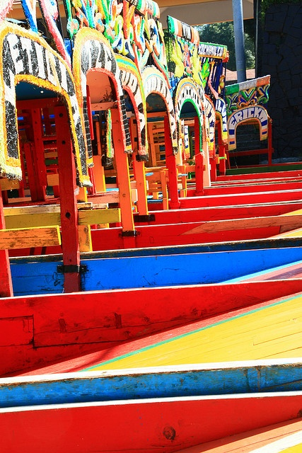 Xochimilco area in Mexico City known for its canals.  A tradition: inhabitants travel in colorful trajinereas (boats). UNESCO Heritage Site.  MEXICO. (by PVCG, via Flickr)
